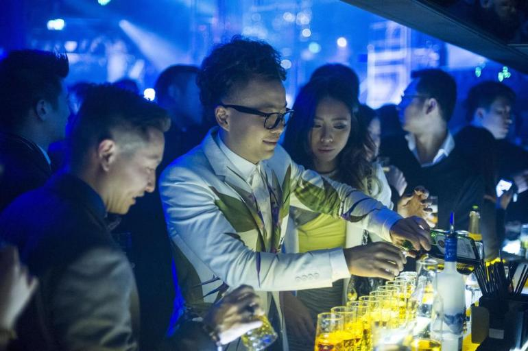 "A man sets up an elaborate row of ""Jaeger Bombs"" (consisting of vodka, Red Bull and Jaegermeister) on the bar at Linx during its soft opening. The club boasts Hong Kong celebrity, singer and actor Nicholas Tse as its Asia Pacific strategic marketing director. The club has a focus on bottle service rather than drinks bought at the bar."