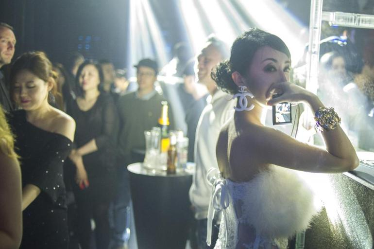 A young woman with oversized Chanel earrings at Linx. The consumption of champagne appeals to China(***)s young elite who see such flamboyance as an expression of sophistication as well as wealth.