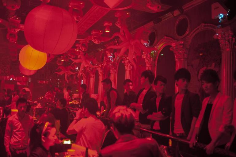 A row of young men survey the tables and dance floor at Club Gaga, one of dozens of nightclubs where Shanghai(***)s young and wealthy party every night of the week.