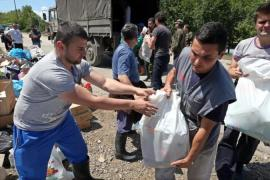 In Bosnia, thousands have volunteered time and resources to help those affected by the floods [EPA]