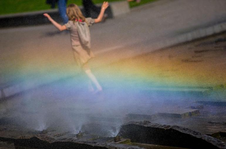 Sprinklers produced a rainbow in the Lustgarten in Berlin, Germany.