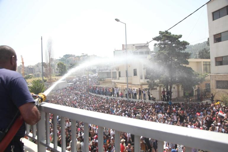 Officials had to spray water at the crowds gathering near the embassy because of the searing heat in Beirut.