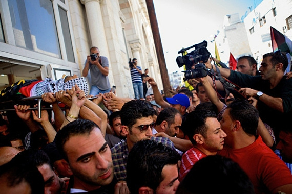 Angry Palestinian mourners chanted slogans against the PA's cooperation with Israel [Gregg Carlstrom, Al Jazeera]