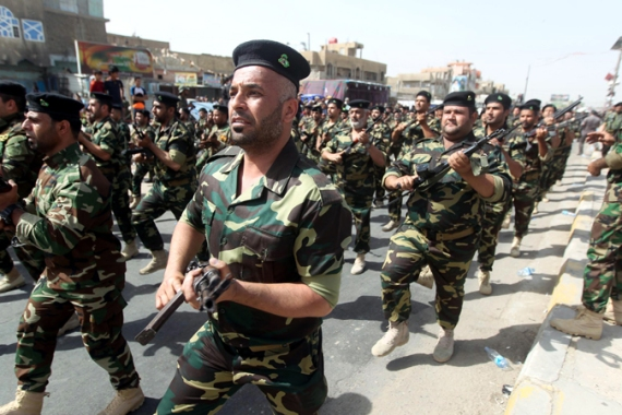 A recent military parade in Baghdad was another sign of the increasing militarisation of the capital [EPA]