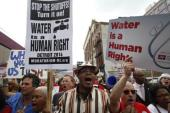 Residents have protested against water cut-offs in Detroit [Getty Images]