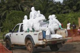 Health workers are at serious risk of contracting Ebola, which spreads through contact with bodily fluids [EPA]