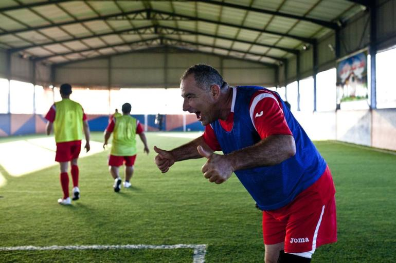 Many of the players refer to the team as a (***)family(***). Mohammed Ali al-Haj, 50, teases the goalkeeper he just scored on. (***)I play football thinking that disability is not a barrier. Nothing can stop me.(***)