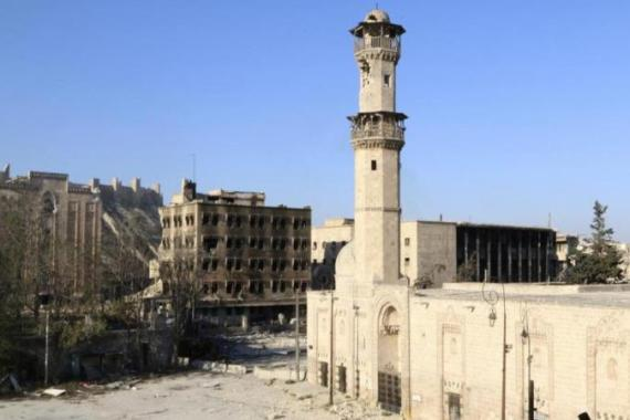 Al-Taroush mosque, the police headquarters and Aleppo citadel before it was bombed [Reuters]