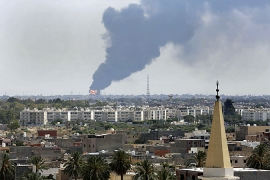 Warring militias battling for control of key population centres in Libya [AP]