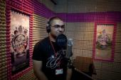 Wael Adel, 30, the manager of Nsaeem Syria radio station, records material in the studio in the northern Syrian city of Aleppo [AFP]