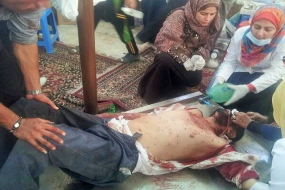 One of many people injured was brought to a makeshift hospital in a Nasr City mosque [D. Parvaz/Al Jazeera]