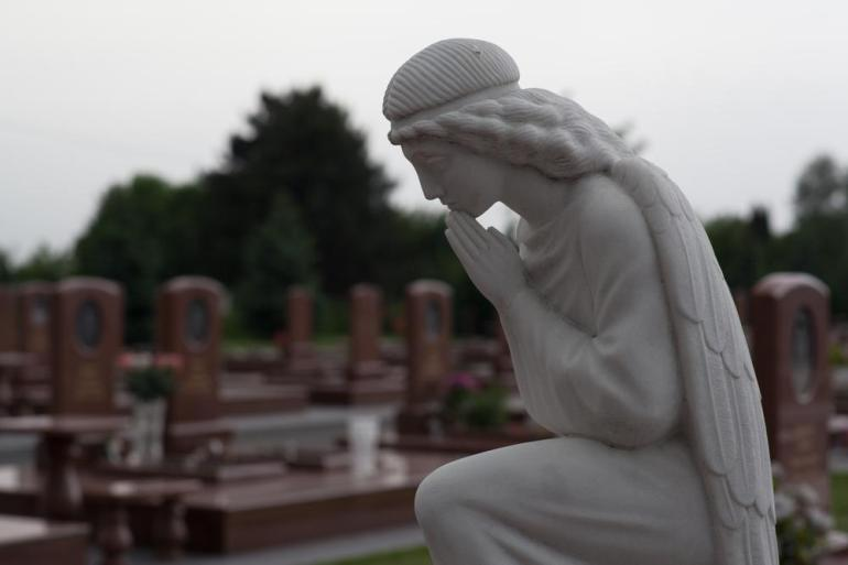 The cemetery where hostages are buried is known as the City of Angels. Some families lost five or six of their relatives in the massacre. [Andrei Kovalenko/Al Jazeera]