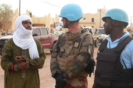 Moussa Ag Assarid, left, chats with French soldiers in Kidal in June 2014 [Kingsley Kobo/Al Jazeera]
