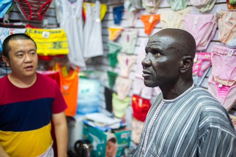 Mohammed, a Nigerian who declined to give his last name, negotiates the price of underwear with a trader at the wholesale market inside the Tianxiu Building. Mohammed had flown from Lagos to purchase underwear wholesale for sale in Nigeria.