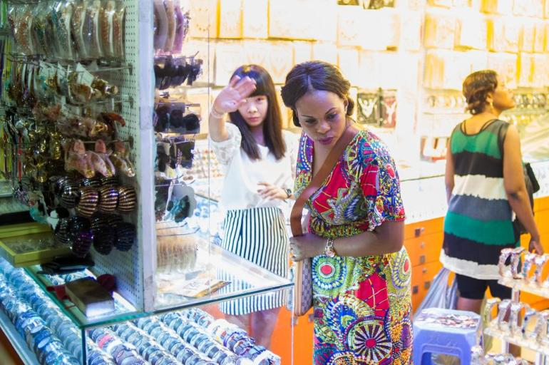African women shop at a wholesale market near Xiaobei metro station.