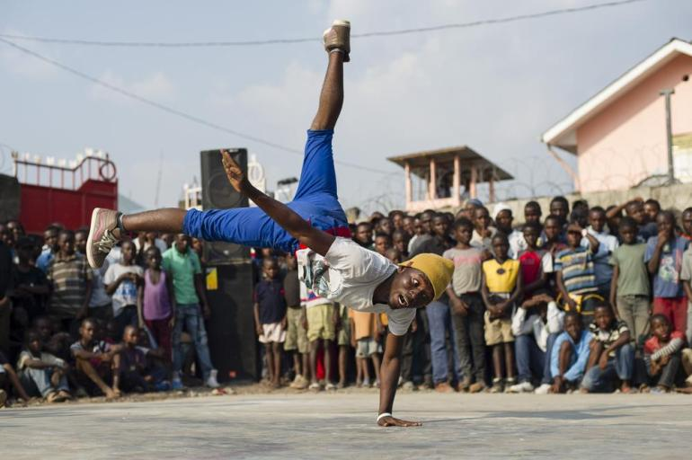 A Congolese dancer break-dances during an exhibition dance at the Salaam Kivu International Film Festival. The group of break-dancers comprise the three winning teams from last year(***)s competition: Rhina Crew, Magic Dance and Street Dancers.