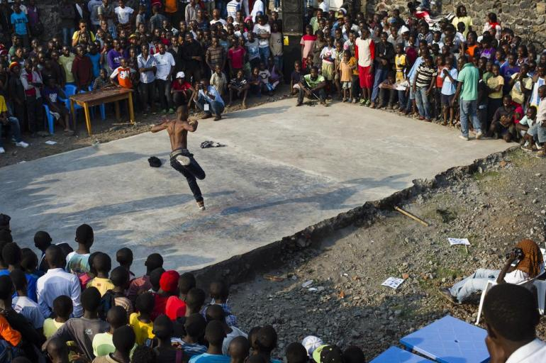 A break dancer performs during a dance.
