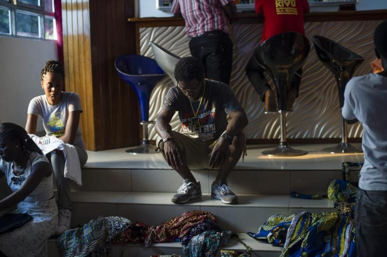 Eric Ndele takes a breather before the start of a fashion show, held as part of the closing ceremony of the SKIFF festival at a hotel in Goma, on July 13.