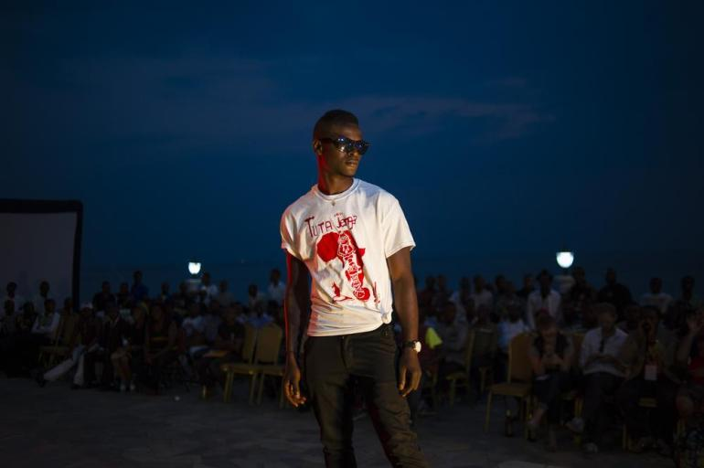 "A model wears one of the T-shirts designed for the festival during a fashion show at the closing event in Goma. Tuta Jenga ao the slogan for this year(***)s festival means ""Will we build or destroy?"" in Kiswahili."