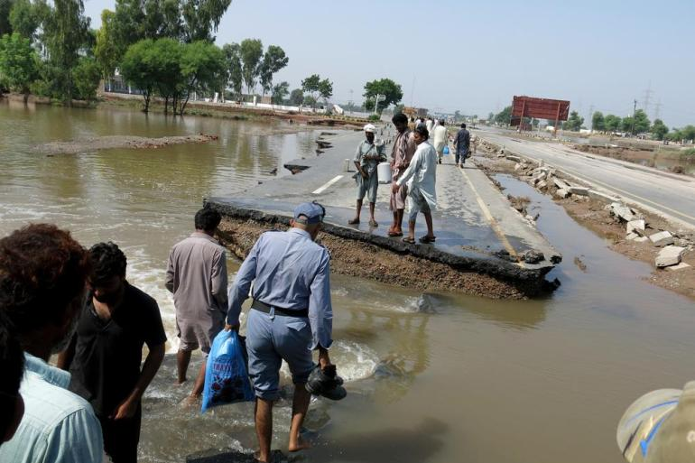 Torrents of water have broken through several major roads. People are seen here walking across the break in the main road linking Multan to Muzaffargarh. Many flood-affected areas are completely cut-off by land, and rescuers can only access them by boat.