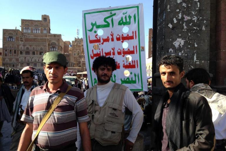 Members of a (***)peoples committee(***) who support the Houthis, guard the gates of Bab al Yemen in Old Sanaa.