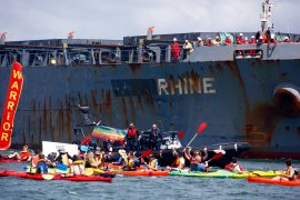 'Climate Warrior' canoes attempt to block coal ships