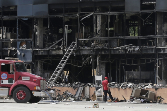 Protesters asking for a probe into the missing students burned government buildings in Guerrero state [Reuters]