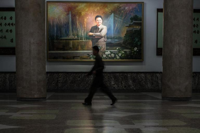 A portrait of Kim Jong II at the main hall of the Grand People's Study House in Pyongyang. [Miguel Toran/Al Jazeera]