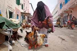 Tax collectors working in Mogadishu markets such as this are increasingly being killed [AP]