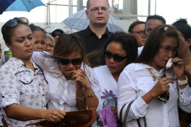 Jeffrey 'Jennifer' Laude's family and German fiance mourn during a funeral procession on Friday [AP]