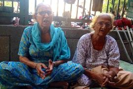Two sisters Leela Kaur, left, and Jasibai, right, lost their families in the riots [Betwa Sharma/ Al Jazeera]