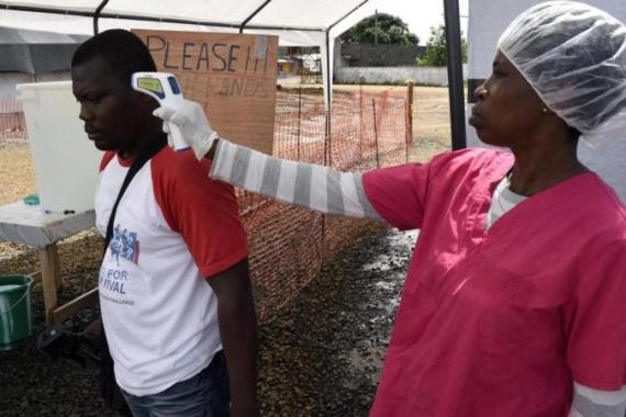 Journalists could be prosecuted for contacting Ebola patients without permission [AFP]
