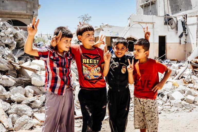 The neighbourhood in Rafah where these boys live was decimated by an air strike, but they still flash the ubiquitous peace/victory sign.