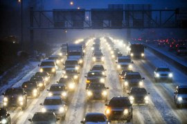 Traffic on Interstate 35 was a reduced to a crawl as the season's first snowstorm hit Minneapolis [EPA]