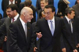 China proposed setting up a committee of regional countries to help Ghani talk to the Taliban, writes Rashid [AFP]