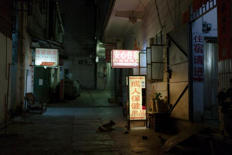 One of the back streets in Dongguan with hostels and adult stores.