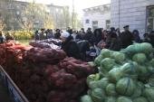 Pro-Russian separatists sell vegetables during the elections in Donetsk [Getty Images]