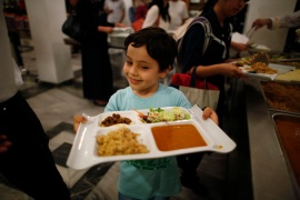 A Muslim boy breaks his fast during the holy month of Ramadan at the Tokyo Mosque [Reuters]