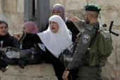 Palestinian women are blocked by Israeli security forces outside the al-Aqsa mosque compound [AFP]