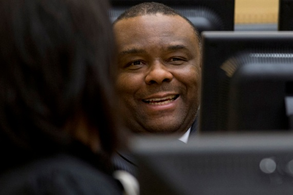 Jean-Pierre Bemba smiles at his trial at the International Criminal Court in The Hague in 2013 [Reuters]