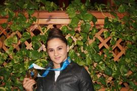 Begaj became the first female weightlifter from the country to win gold [Rozafa Kelmendi/Al Jazeera]