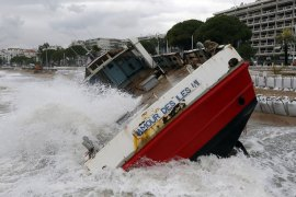 The weather was rough enough for a ship to run aground on a beach in the French Riviera city of Cannes [AFP]