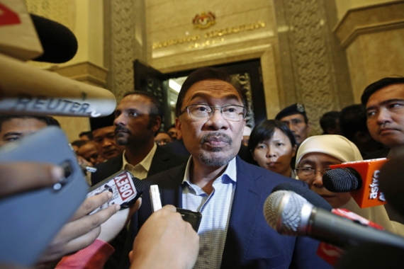 Critics and activists said the case against Anwar is part of the ruling party's move to silence the opposition [Reuters]