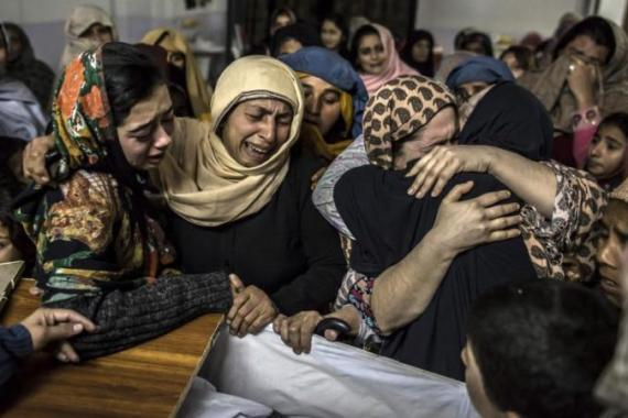 Women mourn Mohammed Ali Khan, 15, a student who was killed during an attack by Taliban gunmen [Reuters]