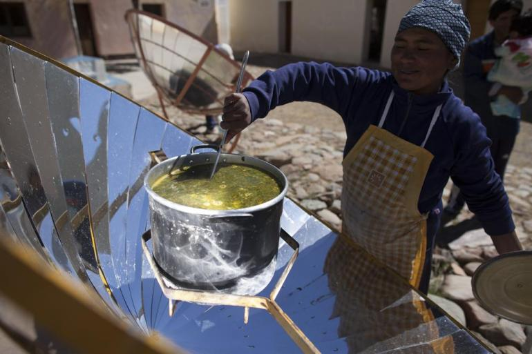 Solar energy can help power kitchens, heating, lighting and even phones. Virginia Bauso roams the desert spreading innovative technology, including a (***)kiosk(***) she invented that cooks food using the sun(***)s rays.