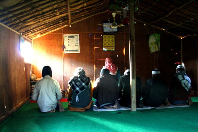 Rohingya offer prayers inside a temporary mosque in a refugee camp in the city of Jammu.