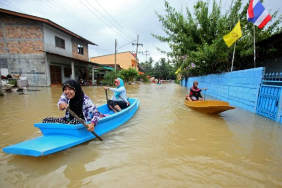 Floodwaters now stand waist-deep or higher in many areas around the Thailand/Malaysia border  [AFP]