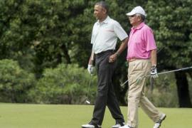 Najib was criticised for travelling to Hawaii where he played golf with President Obama [AFP]