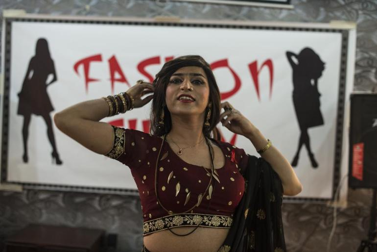 Jannat, 26, performs at a transgender fashion show. She has a master's degree in business administration from the University of Central Punjab and is a professional Khatak dancer.