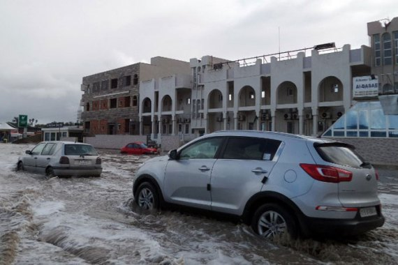 Around 20 per cent of the December average rainfall fell in Tripoli on Wednesday leaving streets under water. [EPA]